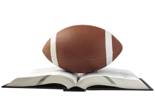 A football over an open book, white background